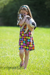 Young girl holding a hunting dog puppy