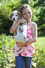 Young girl holding a puppy