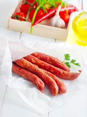 sausages in paper, vegetables in the box
