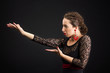 Portrait of spanish woman dancing flamenco on black
