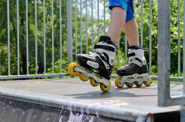 Young girl wearing rollerblades