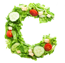 C letter made with salad isolated on white