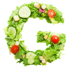 G letter made with salad isolated on white