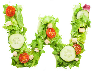 W letter made with salad isolated on white