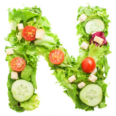 N letter made with salad isolated on white