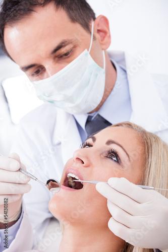 Dentist Examining Patient