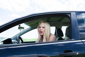 Frustrated Woman Sitting In Car