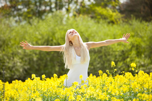 Young Woman Standing In Field