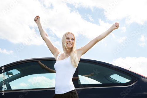 Woman Standing Near Car Raising Her Hand