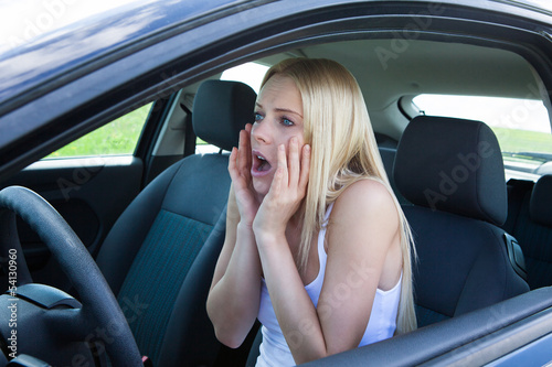 Woman Sitting In Car Screaming
