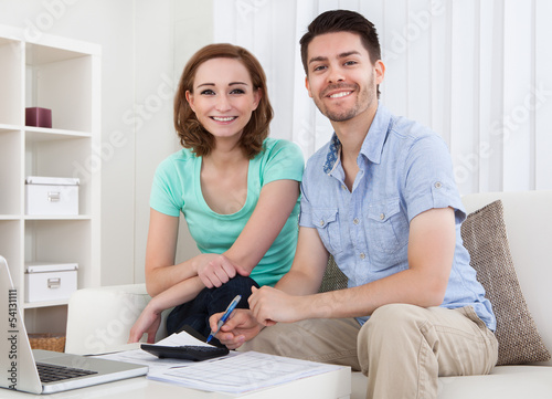 Young couple calculating budget