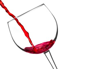 red wine pouring into glass tilted with space for text