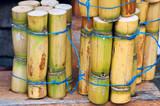 A close up photo of a stack of sugar cane sticks