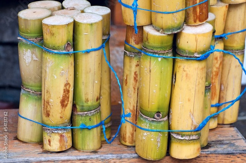 A close up photo of a stack of sugar cane sticks