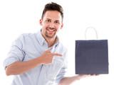 Shopping man pointing at a bag