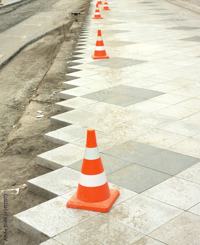 Construction of city pedestrian area gray stone tile