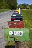 Rural mailboxes lined up along country road