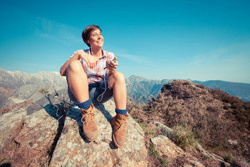 Young Woman at Top of Mountain