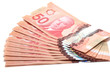 Selective focus of a series of 50 Canadian dollars on white back