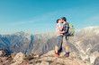 Couple Kissing at Top of Mountain