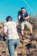 Man Helping His Girlfriend Hiking