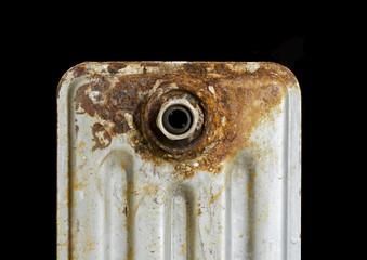 Rusty household cast iron radiator