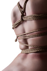 Back of slim girl tied by rope, isolated on white