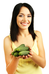 Girl with fresh cucumbers isolated on white