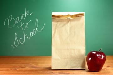 School Lunch Sack Sitting on Teacher Desk