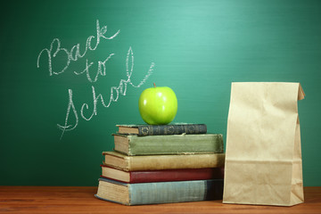 Books, Apple and Lunch on Teacher Desk