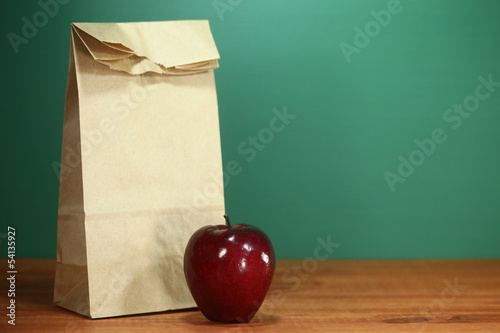 School Lunch Sack Sitting on Teacher Desk