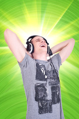 Portrait of a happy young man enjoying music with  headphones