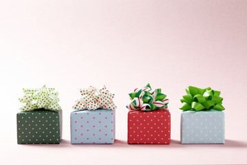 Cute gift boxes on pink background.