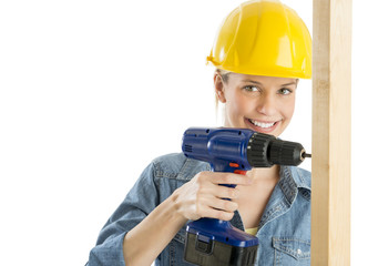 Construction Worker Using Power Drill On Wooden Plank