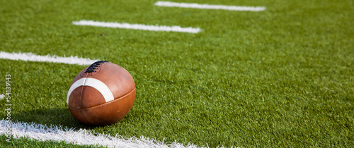 An American football on field - 54139143