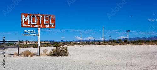 A vintage neon motel sign in the desert