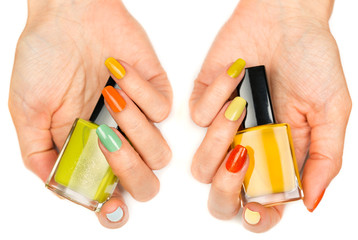 Women's hands with a colored nail varnish
