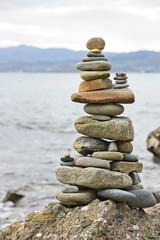 Balanced stack of stones on the seashore