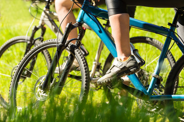 Mountain bikers wearing cycling shoes closeup