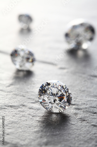 putting diamonds on the surface of the stone closeup.