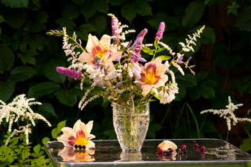 still life bouquet with hemerocallis in a dark background