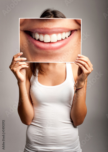 young woman holding a smile
