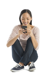 Happy Woman Text Messaging Through Mobile Phone