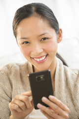 Happy Woman Holding Smart Phone