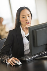 Beautiful Businesswoman Using Computer At Desk In Office