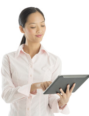 Businesswoman Smiling While Using Digital Tablet