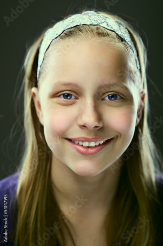 Portrait of a cute smiling teen girl