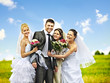 Group bride and groom summer outdoor.