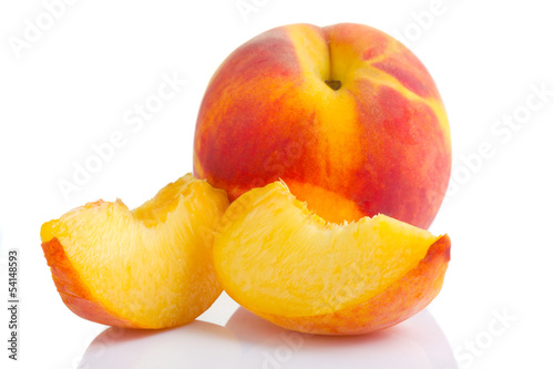 Ripe peach fruit with slices isolated on white