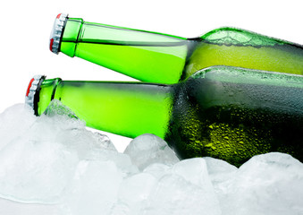 Close-up Two green bottles of beer with condensation cool in ice